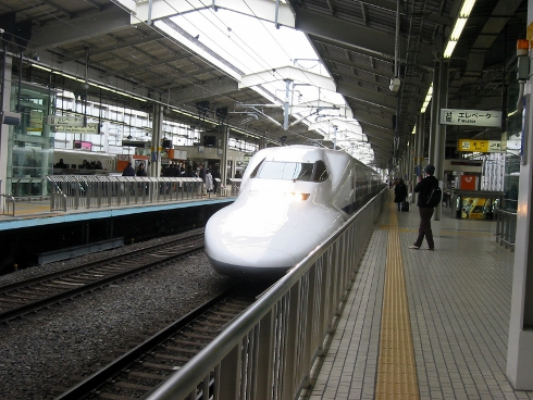 Shinkansen train stopping at Kyoto Station