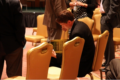 """P.J. signs a copy of his new book, """"The Green to Gold Business Playbook"""""""